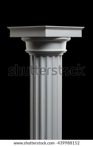 plaster column on a black background - stock photo