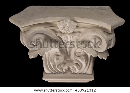 plaster graceful decorations on the columns on a black background