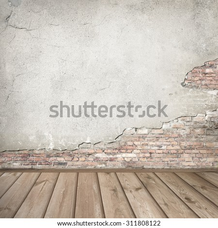 plastered brick wall and wood interior background texture - stock photo