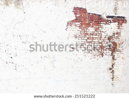 plastered wall with exposed brick wall  - stock photo
