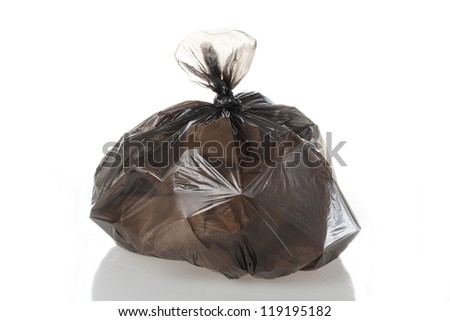Plastic bag full of rubbish on isolated white background - stock photo