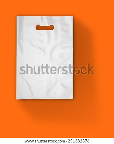 Plastic bag on orange with shadow (with clipping path) - stock photo