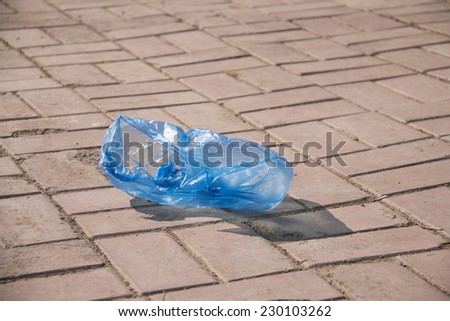 Plastic bag thrown on the street - stock photo