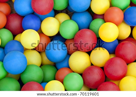 Plastic balls in colors of blue, red, green, yellow and orange - stock photo