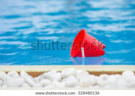 Plastic beach kids toys at the swimming pool on vacation - stock photo