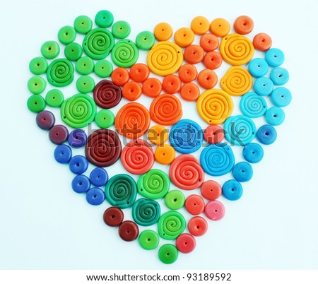 Plastic beads in the form of the heart