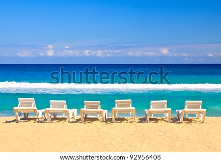 Plastic beds on the cuban beach of Varadero in a beautiful summer day with a clear blue sky - stock photo