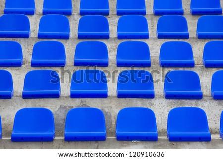 plastic blue seats on football stadium - stock photo