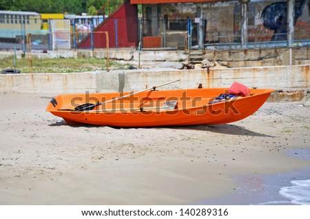 Plastic boat at beach lifeguard station, Odessa, Ukraine - stock photo