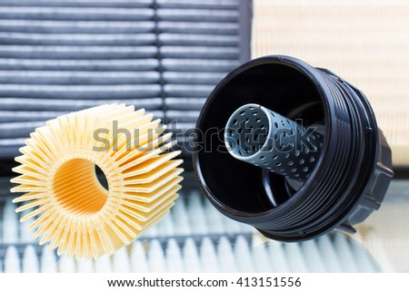 plastic body and insert the oil filter cartridge filter car engine. horizontal photo - stock photo