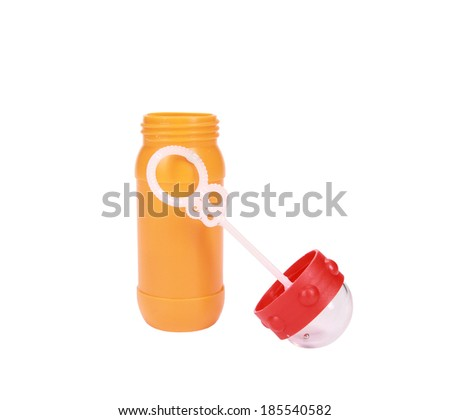 Plastic bottle and bubble wand isolated on white - stock photo