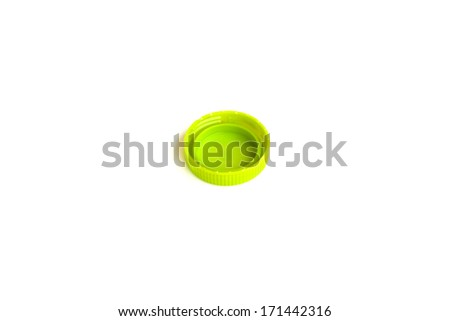plastic bottle caps on white background - stock photo