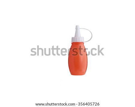 plastic bottle of ketchup on white background