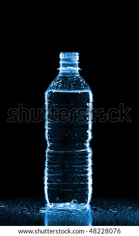 Plastic bottle of water isolated on black - stock photo