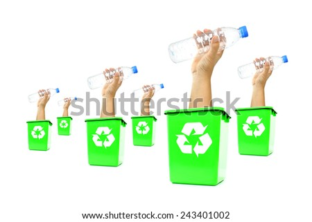 Plastic bottle on hand inside of recycling bin, White background. - stock photo