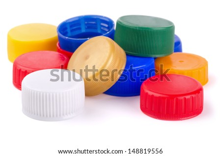 Plastic bottle screw caps isolated on white - stock photo