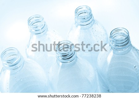 Plastic bottle with water drops - stock photo