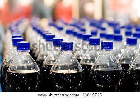 Plastic bottles in shop - stock photo