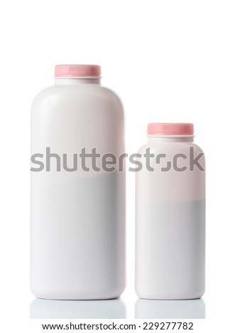 plastic bottles of body care and beauty products on white