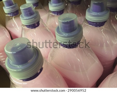 Plastic bottles of detergent in ready to be bought in the supermarket - stock photo