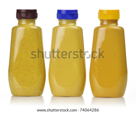plastic  bottles of honey ,dijon and spicy brown mustard - stock photo