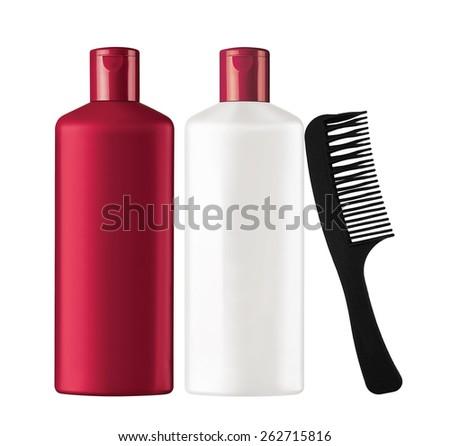 Plastic bottles shampoo and black comb isolated on white background - stock photo