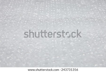 Plastic bubble wrap. Soft packing material. Safety fragile delivery. - stock photo