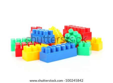 Plastic building blocks on white, colorful children's toys