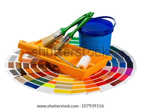 plastic can with paint, roller, brushes and bright palette of colors - stock photo