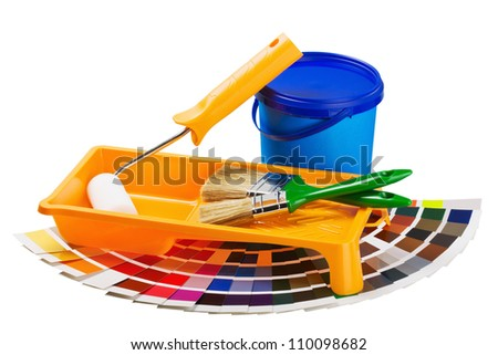 plastic can with paint, roller, brushes isolated on white background - stock photo