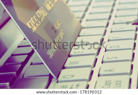plastic card on computer keyboard - internet shoping concept - stock photo