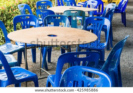 Plastic chair and table set for dining in the local restaurant. - stock photo