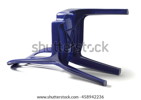 Plastic Chair with Broken Leg Lying on White Background - stock photo