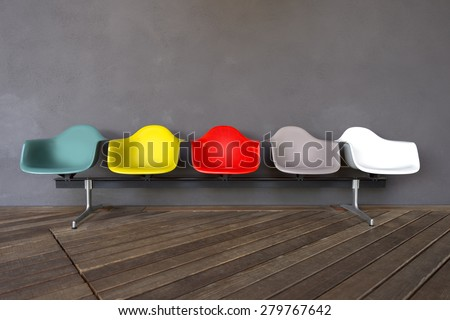 Plastic chairs isolated on gray background and wooden floor - stock photo