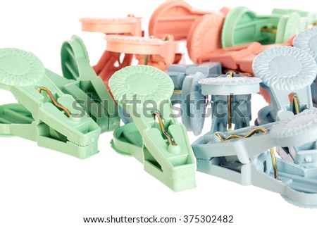Plastic Clothes Pegs on White Background