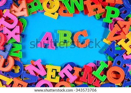 Plastic colored alphabet letters ABC on a blue background