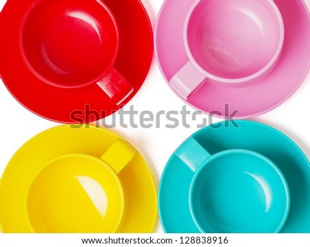 plastic colorful cups and plates - perfect for picnic isolated on white