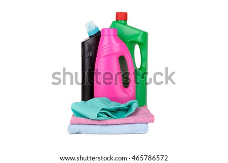 Plastic colorful detergent bottle, blue rubber glove and cleaning towels, isolated on white background.