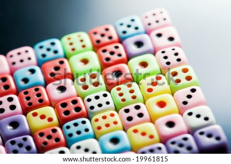 Plastic colorful dices over glass surface