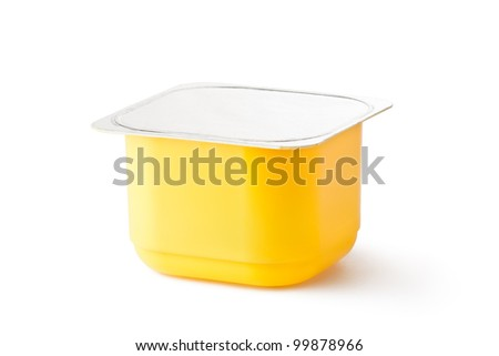 Plastic container for dairy products with foil lid. Isolated on a white. - stock photo