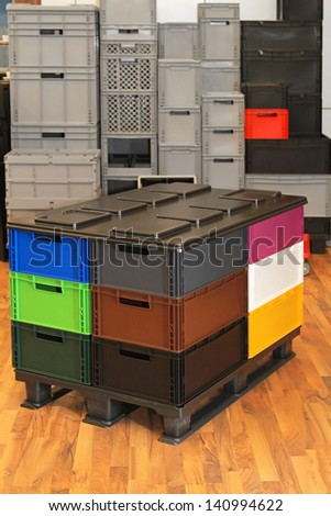 Plastic crates and boxes at transport pallet