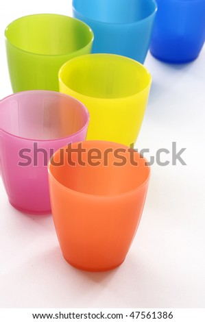 Plastic cups of various color - stock photo