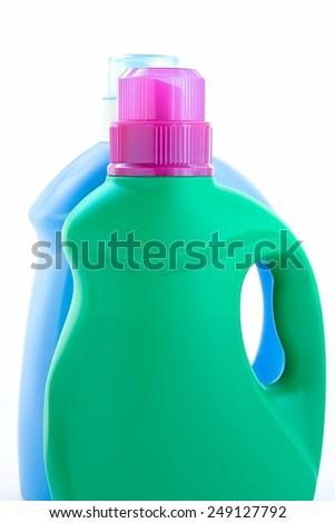 Plastic detergent bottles on white background. - stock photo