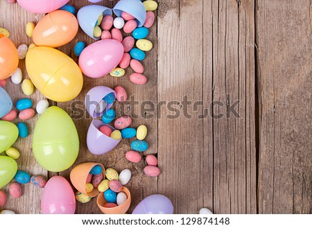 Plastic Easter Eggs Filled With Candy On A Wooden Background