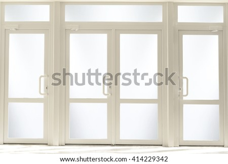 Plastic entrance doors with glass - stock photo
