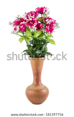 Plastic flowers in a pottery vase isolated on white background. - stock photo