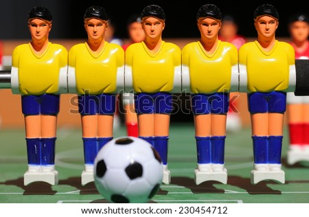 plastic football player. board game.Tabletop football game. For entertainment sports. - stock photo