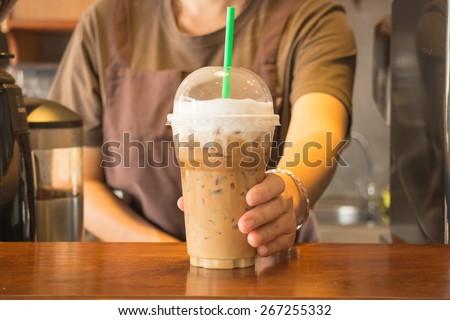 Plastic glass of iced coffee cappuccino, stock photo - stock photo