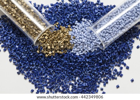 plastic granules, blue and gold close up