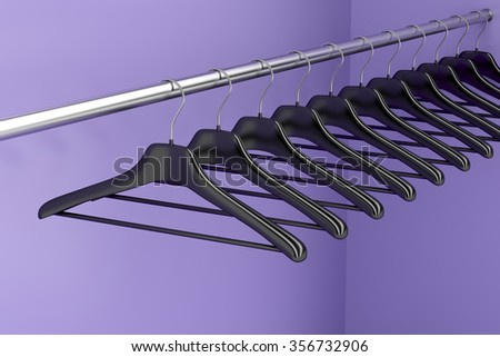Plastic hangers hanging on rod in the closet - stock photo